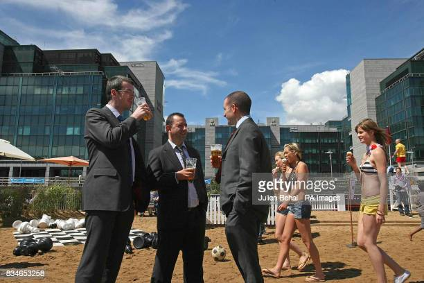 Office workers enjoy a few pints and ladies enjoy ice cream in the sunshine at Ireland's first urban beach in Dublin at George's Dock at the...