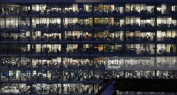 Office workers for IPC Media work into the night in the Blue Fin Building in Southwark on January 16 2013 in London England