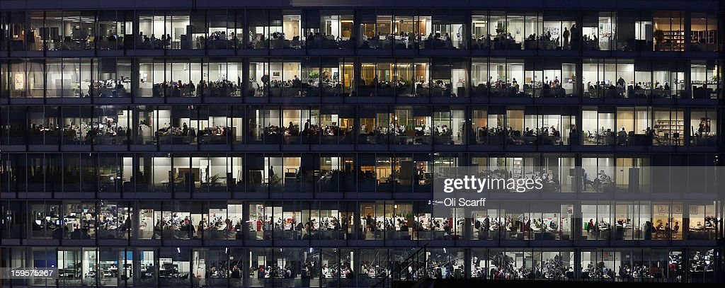 Office workers for IPC Media work into the night in the Blue Fin Building in Southwark on January 16, 2013 in London, England.