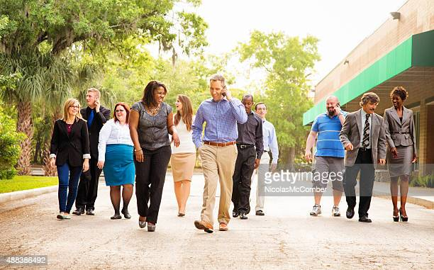 Office workers group walking from parking to work place