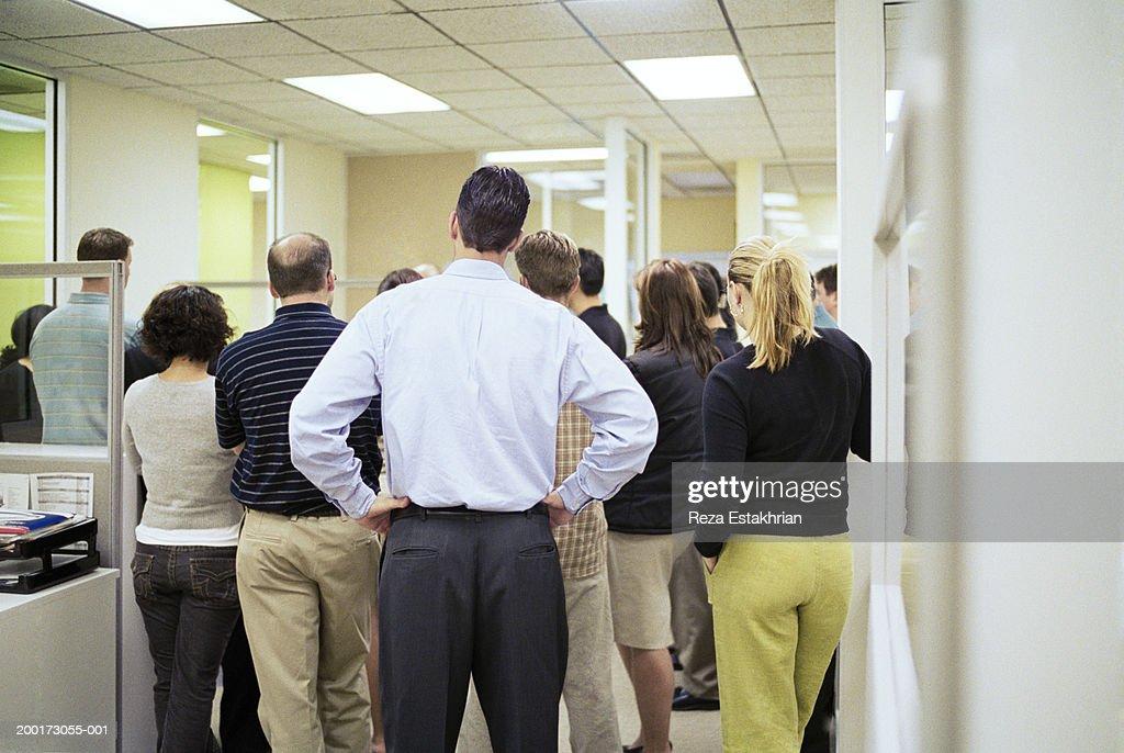 Office workers having meeting, rear view