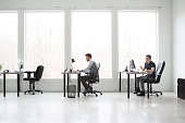 Office workers working in a bright,modern office space.