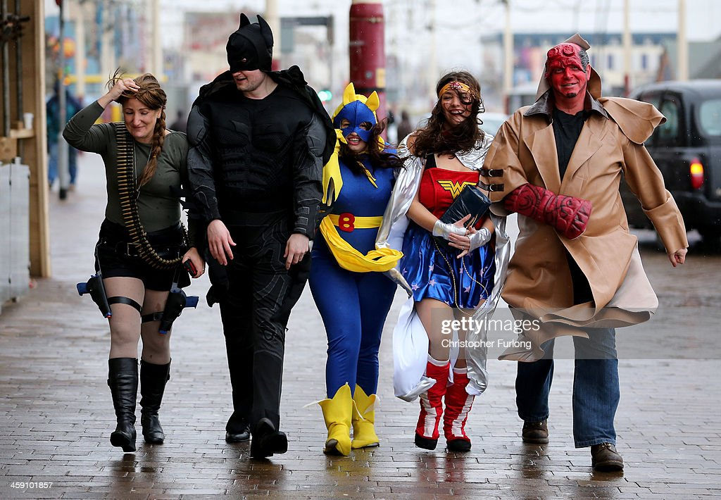 Office workers, in fancy dress celebrating Christmas, battle against the rain and gale force winds on Blackpool promenade on December 23, 2013 in Blackpool, United Kingdom. The Met Office has issued a number of severe weather warnings for heavy rain and high winds and is warning that it may lead to some travel disruption as people make their journeys for Christmas.