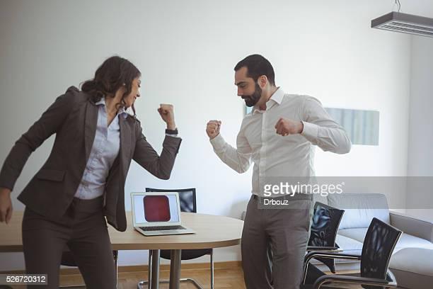 Office workers joking at work