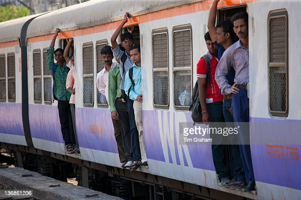Office workers on crowded commuter train of Western Railway near Mahalaxmi Station on the Mumbai Suburban Railway India