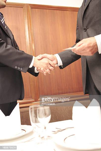 Office workers shaking hands