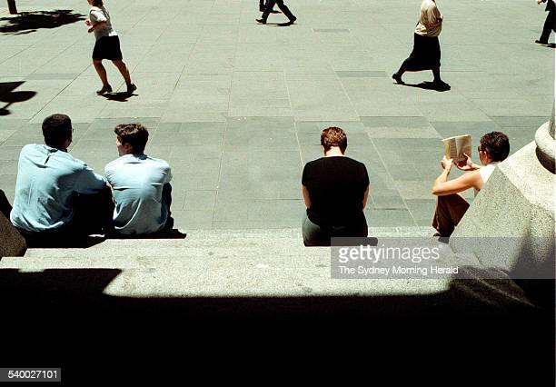 Office workers sit in the sun on the steps of the GPO building during lunch hour Martin Place Sydney 21 December 1999 SMH Picture by NARELLE AUTIO