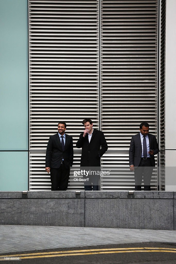 Office workers take a cigarette break adjacent to an office block in Southwark on January 7, 2013 in London, England.