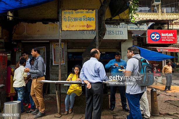 Office workers take a quick lunch at a street food joint Mumbai is often called a dream city and the financial capital of the country where people...