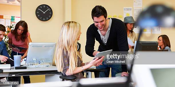 Office Workers Using a touch pad