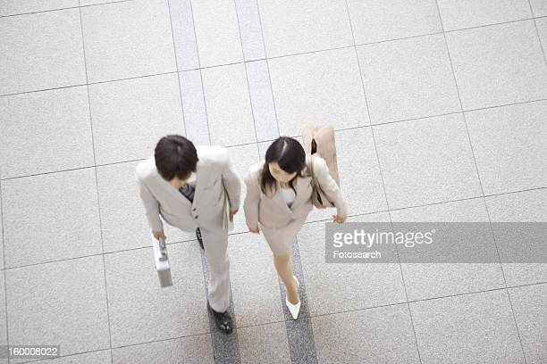 Office workers walking along together