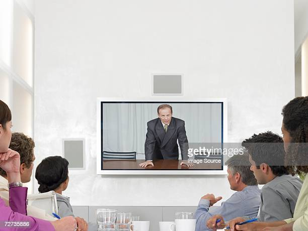 Office workers watching video conference