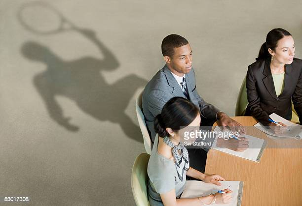 office workers with revealing shadows