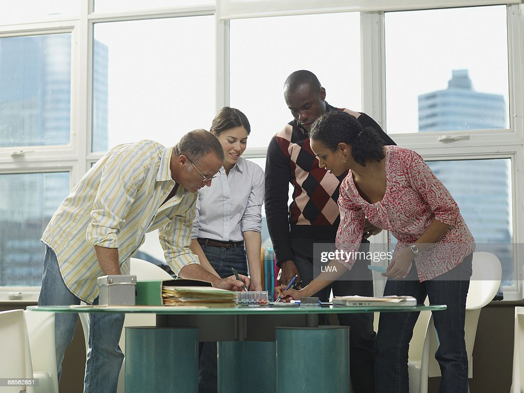 Office Workers Writing Out Ideas During Meeting : Stock Photo