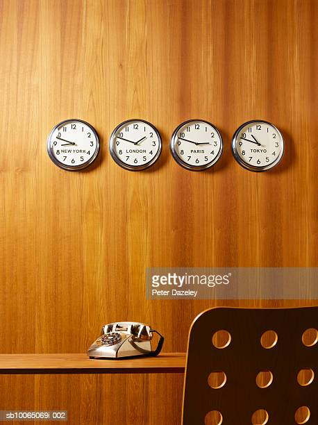 Office world time clocks, desk, chair and telephone