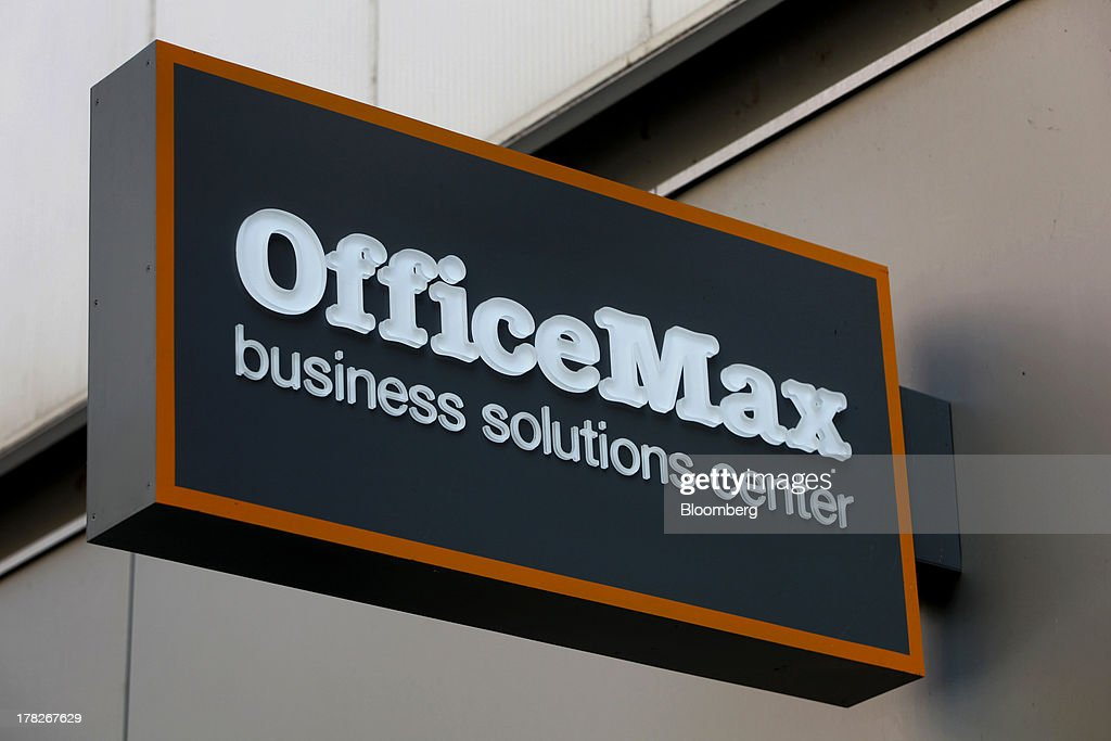 OfficeMax Inc. signage is displayed outside of the company's new Business Solutions Center in Chicago, Illinois, U.S., on Tuesday, Aug. 27, 2013. The OfficeMax Business Solutions Center provides local businesses with services including designed marketing, web, document, IT and shipping service. Photographer: Tim Boyle/Bloomberg via Getty Images