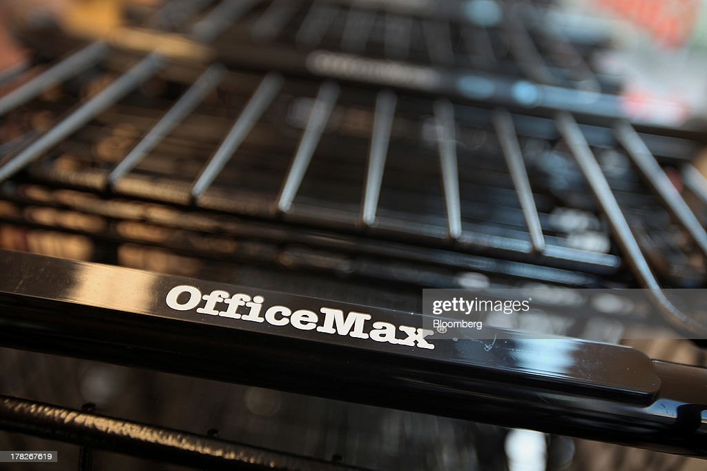 OfficeMax Inc. signage is seen on a shopping cart at the company's new Business Solutions Center in Chicago, Illinois, U.S., on Tuesday, Aug. 27, 2013. The OfficeMax Business Solutions Center provides local businesses with services including designed marketing, web, document, IT and shipping service. Photographer: Tim Boyle/Bloomberg via Getty Images