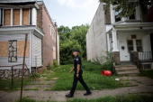 Officer Adam Fulmore of the Camden County Police Department goes on a foot patrol on August 22 2013 in the Parkside neighborhood of Camden New Jersey...