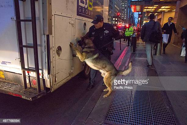 K9 officer and his dog inspect a truck randomly flagged for inspection on Lexington Avenue outside Grand Central Terminal Following the release of a...