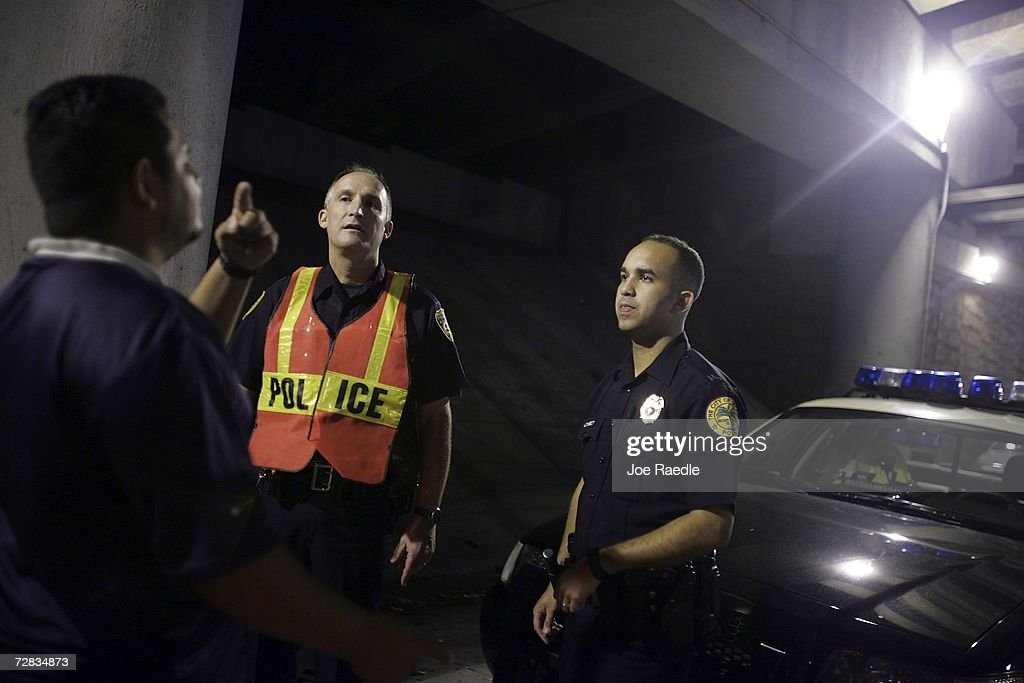 Officer Andrew Kuncas from the City of Miami Beach police department (L) and Officer Umset Ramos from the City of Miami police department conduct a field sobriety test at a DUI checkpoint December 15, 2006 in Miami, Florida. The city of Miami, with the help of other police departments, will be conducting saturation patrols and setting up checkpoints during the holiday period looking to apprehend drivers for impaired driving and other traffic violations.