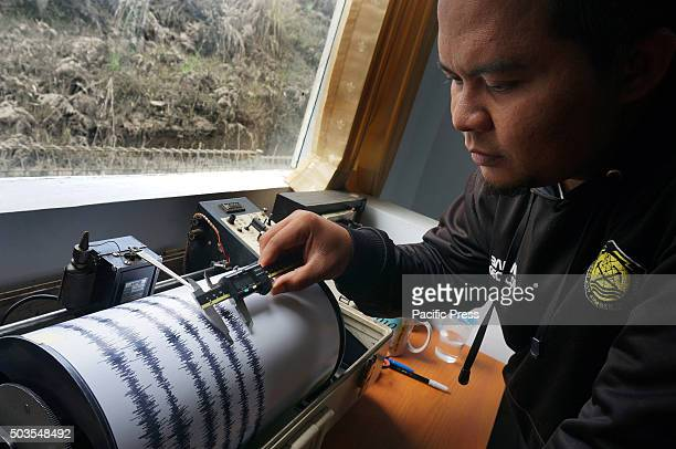 Officer at The Center for Volcanology and Geological Hazard Mitigation measures the maximum amplitude of the tool seismograph at Bromo Volcano...