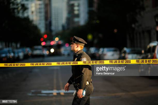 Officer blocks a street as emergency personal respond after a man driving a rental truck struck and killed eight people on a jogging and bike path in...