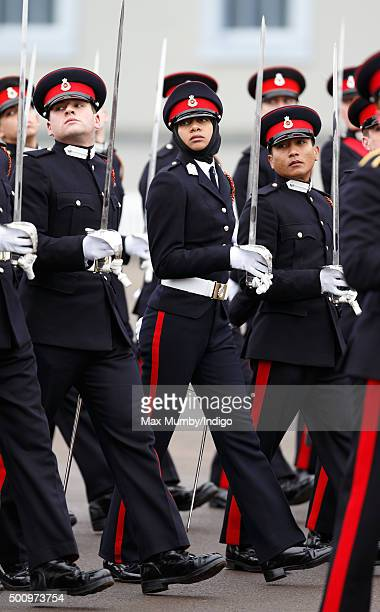 Officer Cadet Fatma Hassan Seleh Mubarak Bin Hamdan from the UAE wears a headscarf under her peaked cap and long trousers as she takes part in the...