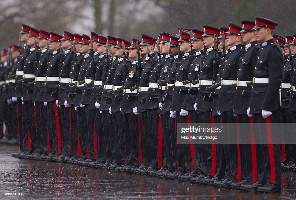 Officer Cadets take part in the Sovereign's Parade during heavy rain at the Royal Military Academy Sandhurst on December 14, 2012 in Sandhurst, England. The parade marks the completion of 44 weeks of training for 200 young people who will be commissioned into the British Army and the armies of 13 overseas countries. Senior Under Officer Sarah Hunter-Choat became the fourth woman in the Royal Military Academy's history to receive the prestigious Sword of Honour which is awarded to the best Officer Cadet on the course.
