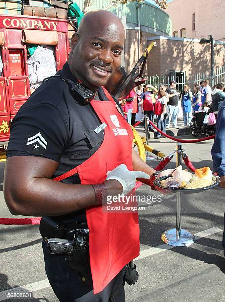 Officer Deon Joseph attends the Los Angeles Mission's Thanksgiving for skid row homeless at the Los Angeles Mission on November 21 2012 in Los...