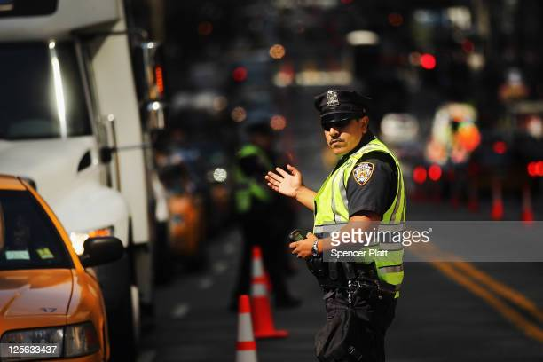 NYPD officer directs traffic outside of the United Nations as world leaders arrive in New York for the start of the UN General Assembly on September...