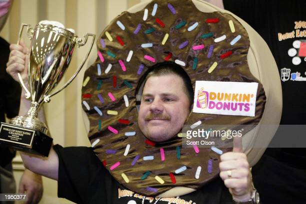 Officer Gary Sellers of the Highland Illinois police department celebrates his victory at the 2003 World Cop Donut Eating Championship April 24 2003...