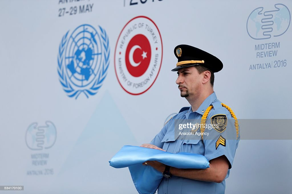 A UN officer holds the United Nations flag during the ceremony for the raising United Nations flag at the Titanic Hotel where Midterm Review of the Istanbul Programme of Action, in Antalya, Turkey on May 25, 2016. The Midterm Review conference for the Istanbul Programme of Action for the Least Developed Countries will take place in Turkey's Antalya from 27-29 May 2016.
