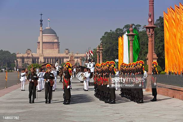 Officer inspecting troops at Changing of the Guard Ceremony in front of Rashtrapati Bhavan, the residence of the president of India.