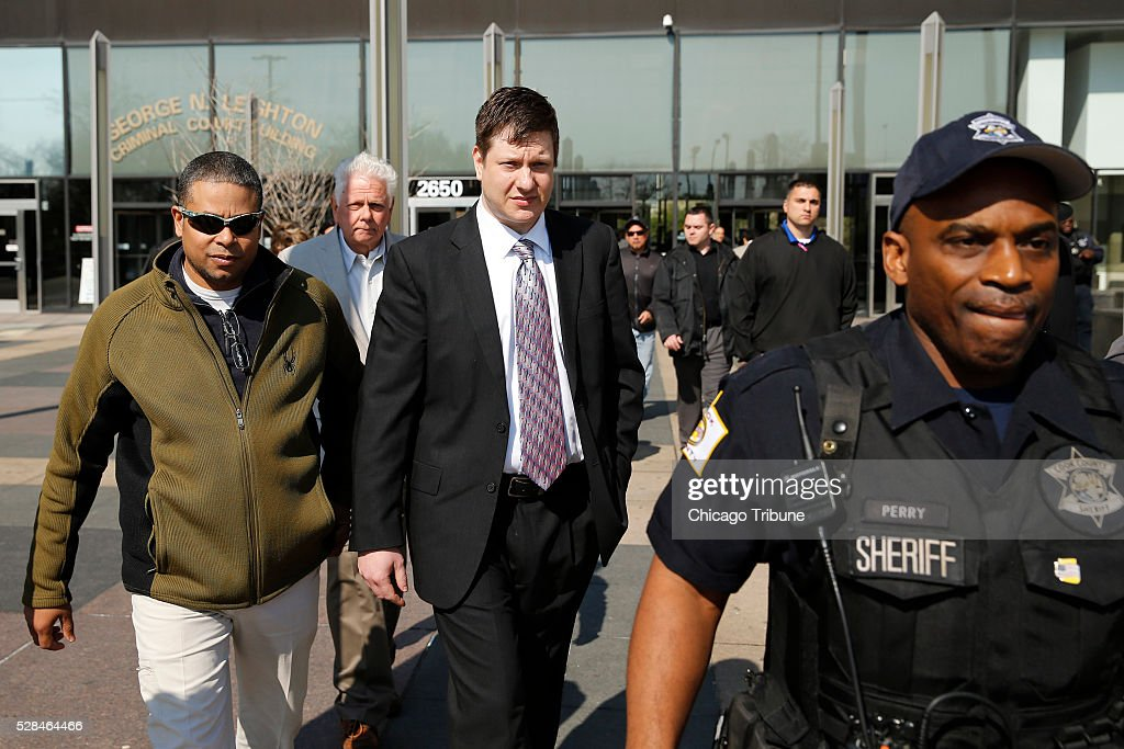 Officer Jason Van Dyke, center, leaves the Leighton Criminal Court Building in Chicago following a court appearance on Thursday, May 5, 2016.