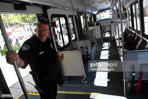 RTD officer John Terry left checks out the interior of the new 16th Street Free MallRide bus on display at Skyline Park on the 16th street mall on...
