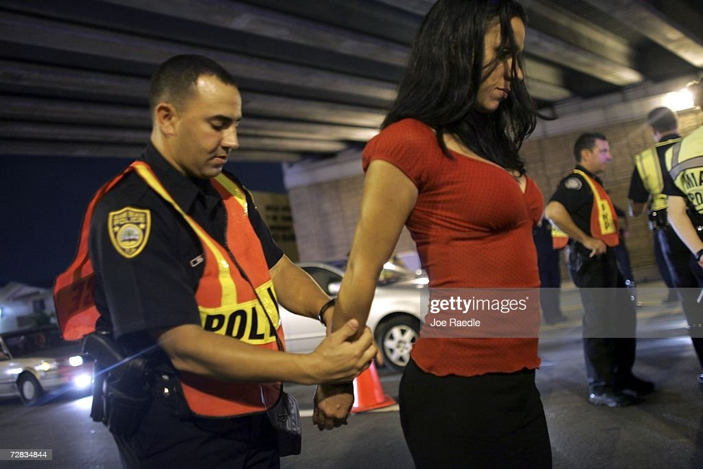 Officer Kevin Millan from the City of Miami Beach police department arrests a woman after she failed a field sobriety test at a DUI checkpoint December 15, 2006 in Miami, Florida. The women failed a breathalyzer test by blowing into the device and receiving two readings one at .190 the other .183, which is twice the legal limit in Florida. The city of Miami, with the help of other police departments, will be conducting saturation patrols and setting up checkpoints during the holiday period looking to apprehend drivers for impaired driving and other traffic violations.