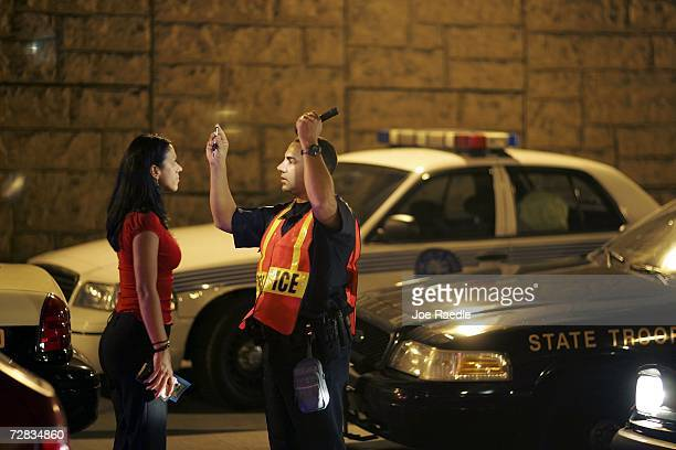 Officer Kevin Millan from the City of Miami Beach police department conducts a field sobriety test at a DUI traffic checkpoint December 15 2006 in...