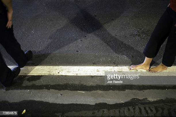 Officer Kevin Millan from the City of Miami Beach police department instructs a woman how to walk the white line during a field sobriety test at a...