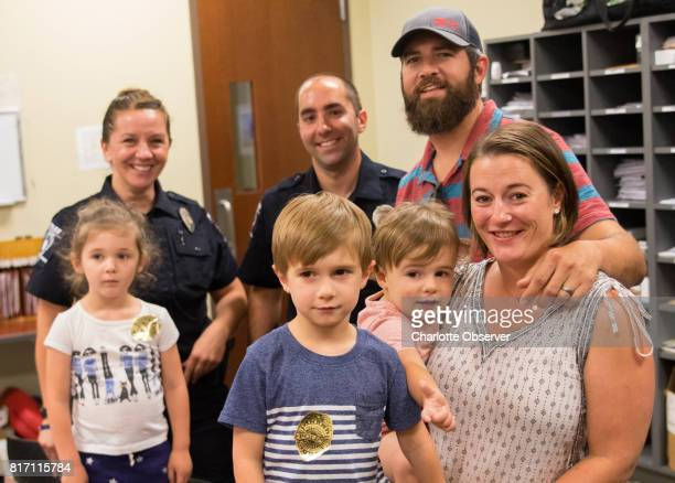 CMPD officer Nikolina Bajic left rear and Lawrence Guiler stand with John and Sarabeth Ogburn and their kids from left Birdie Huck and Revel 2 Guiler...