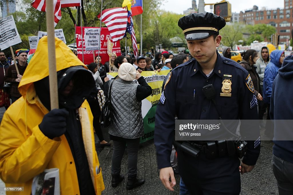 NYDP officer polices as people take part in a rally during Labor Day celebrations on May 1, 2016 in New York City.