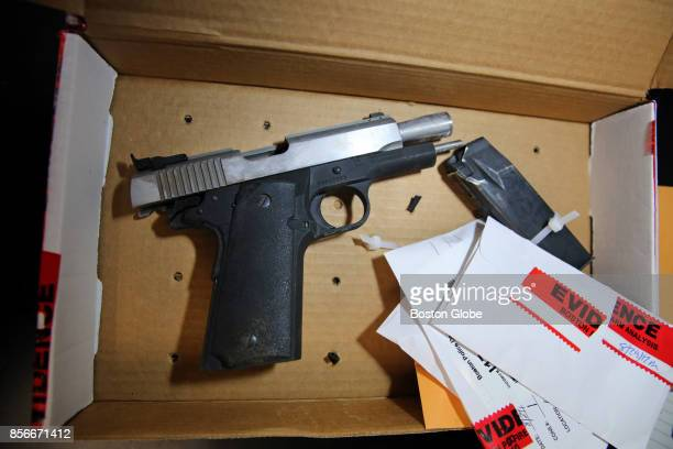 Officer Richard Rackauskas processes a 45 Caliber Pistol from a crime scene in the Firearms Analysis Unit evidence vault at Police Headquarters in...