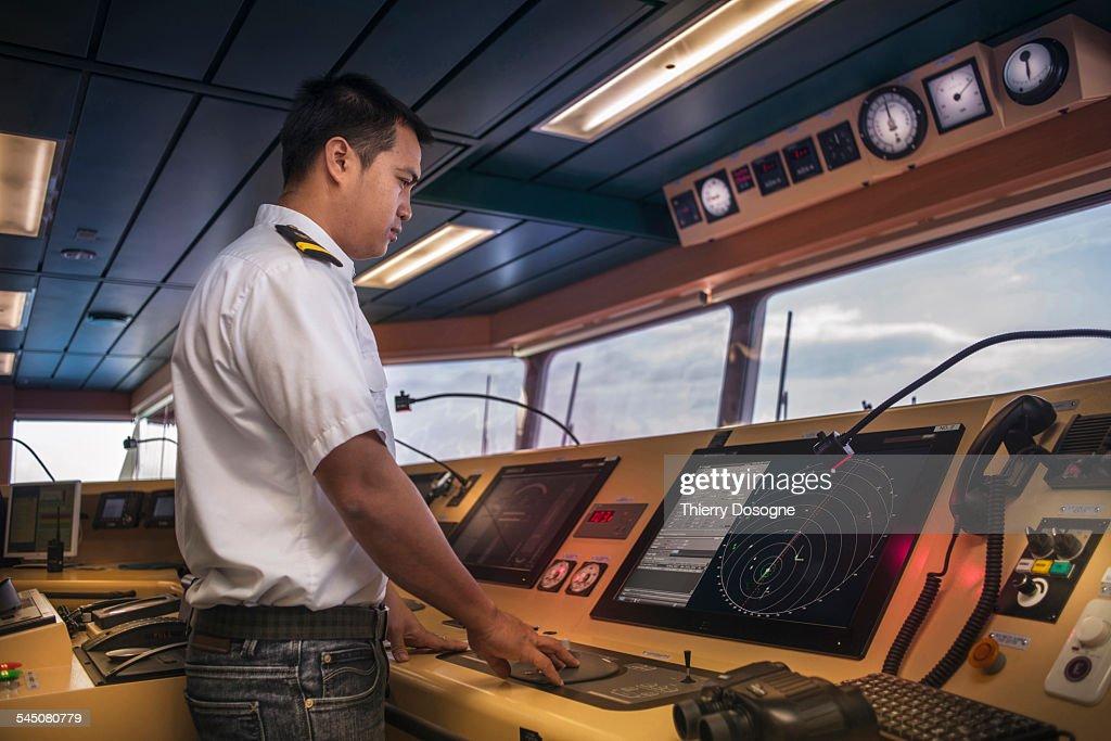 Officer ship looking radar screen
