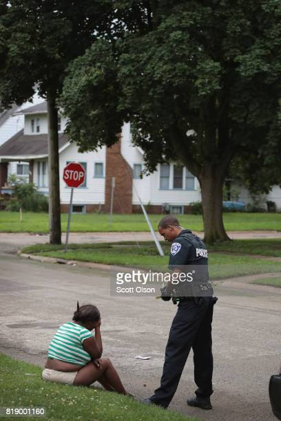 Officer Sims questions a woman following a fight outside of a suspected drug house on July 12 2017 in Rockford Illinois The woman was arrested and...