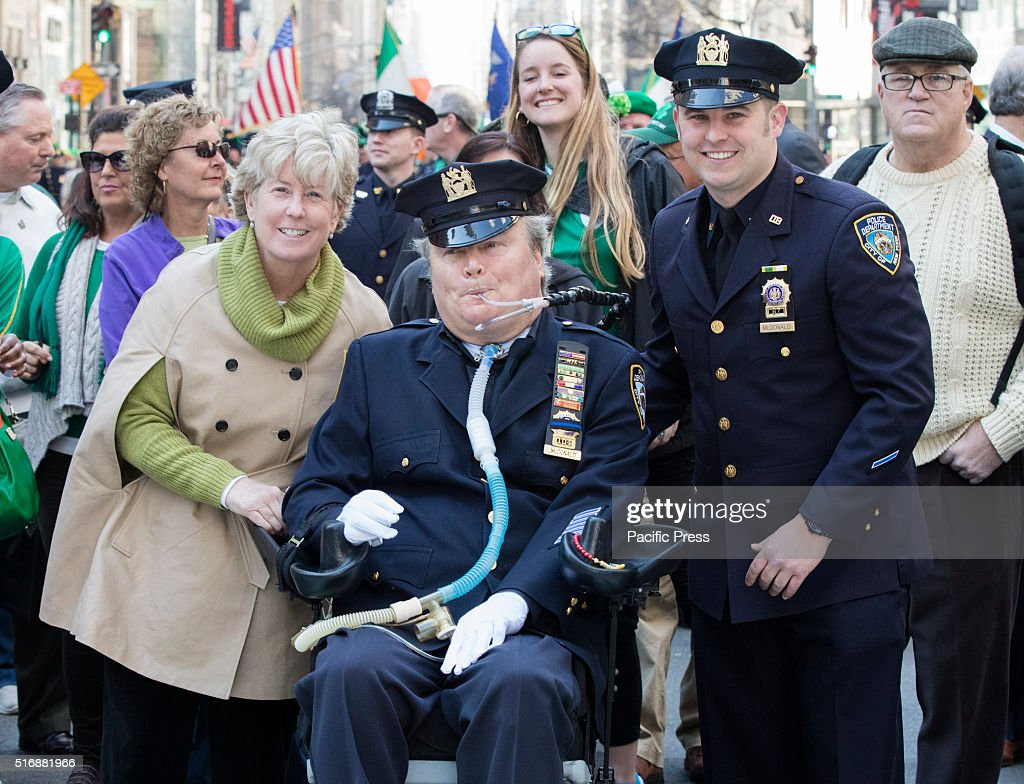 NYPD, Officer, Steven McDonald, his wife, Patricia Ann and Son participated on the 255th New York City St. Patrick's Day Parade. The parade honors the patron saint of Ireland and was held for the first time in New York 14 years before the signing of the Declaration of Independence.