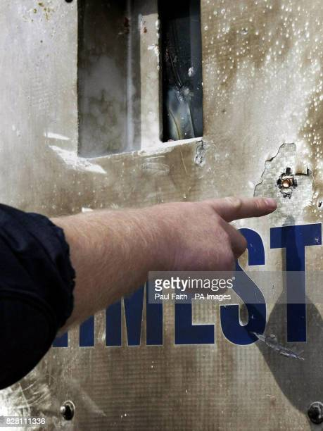 A PSNI officer Sunday September 11 2005 points to one of the bullets lodged in a police landrover during yesterday's rioting The Chief Constable Sir...