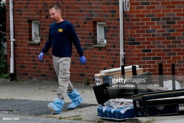 A FBI officer walks outside of suspect Sayfullo Saipov's apartment on November 1 in Paterson New Jersey A pickup driver killed eight people in New...