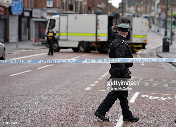 PSNI officer watches on following a suspected car bomb attack on a prison officer at Hillsborough Drive on March 4 2016 in Belfast Northern Ireland...