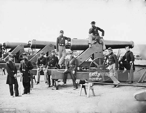 Officers and men of the 3rd Regiment Massachusetts Heavy Artillery stand next to their Columbiad guns Fort Totten Washington DC 1865