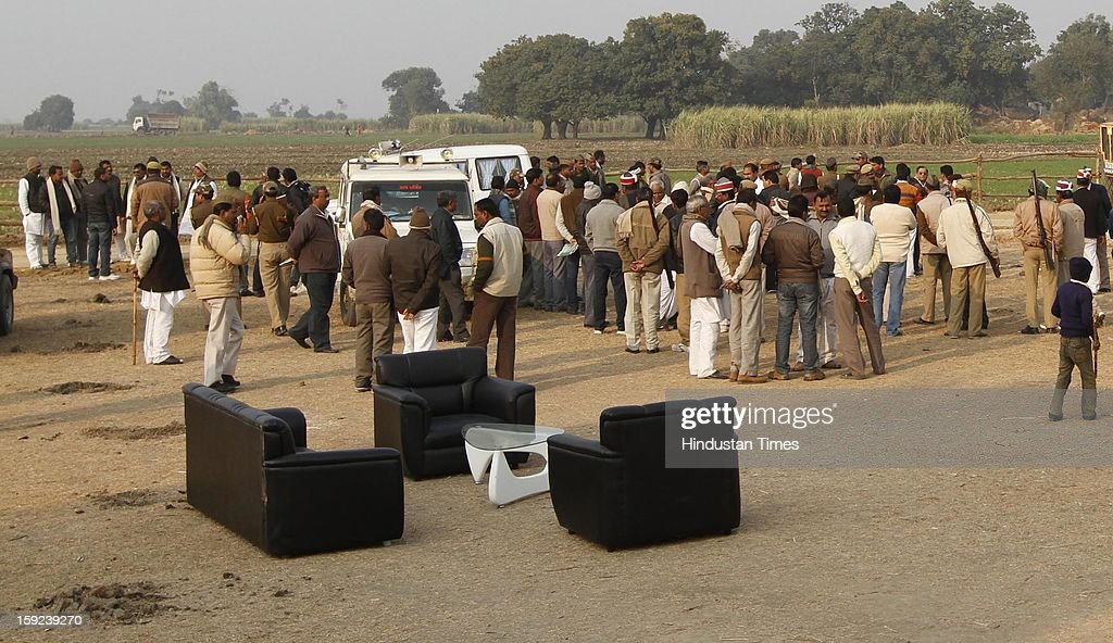 Officers and police present at the site prepared for camp ahead of Chief Minister Akhilesh Yadav's visit to native village of Delhi Gang Rape victim on January 10, 2013 in Ballia, India. Uttar Pradesh administration is working overtime to prepare for Chief Minister Akhilesh Yadav's expected visit on January 12 to give a cheque to the father of the gangrape victim who died in Singapore after being brutally raped and tortured on a bus.
