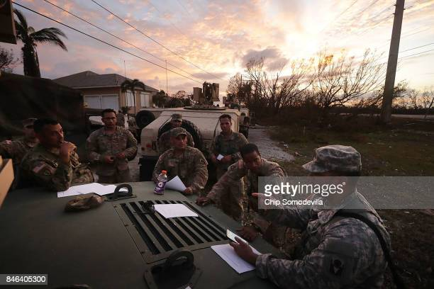 Officers and team leaders from the Florida Army National Guard's Delta Company 1st Battallion 124th Infantry 53rd Infantry Brigade Combat Team...